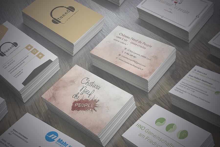 <span>Business Cards</span><i>→</i>